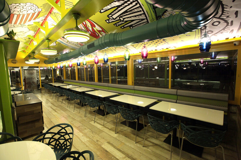 Seating space global falcon restaurant - hummingbird hotel