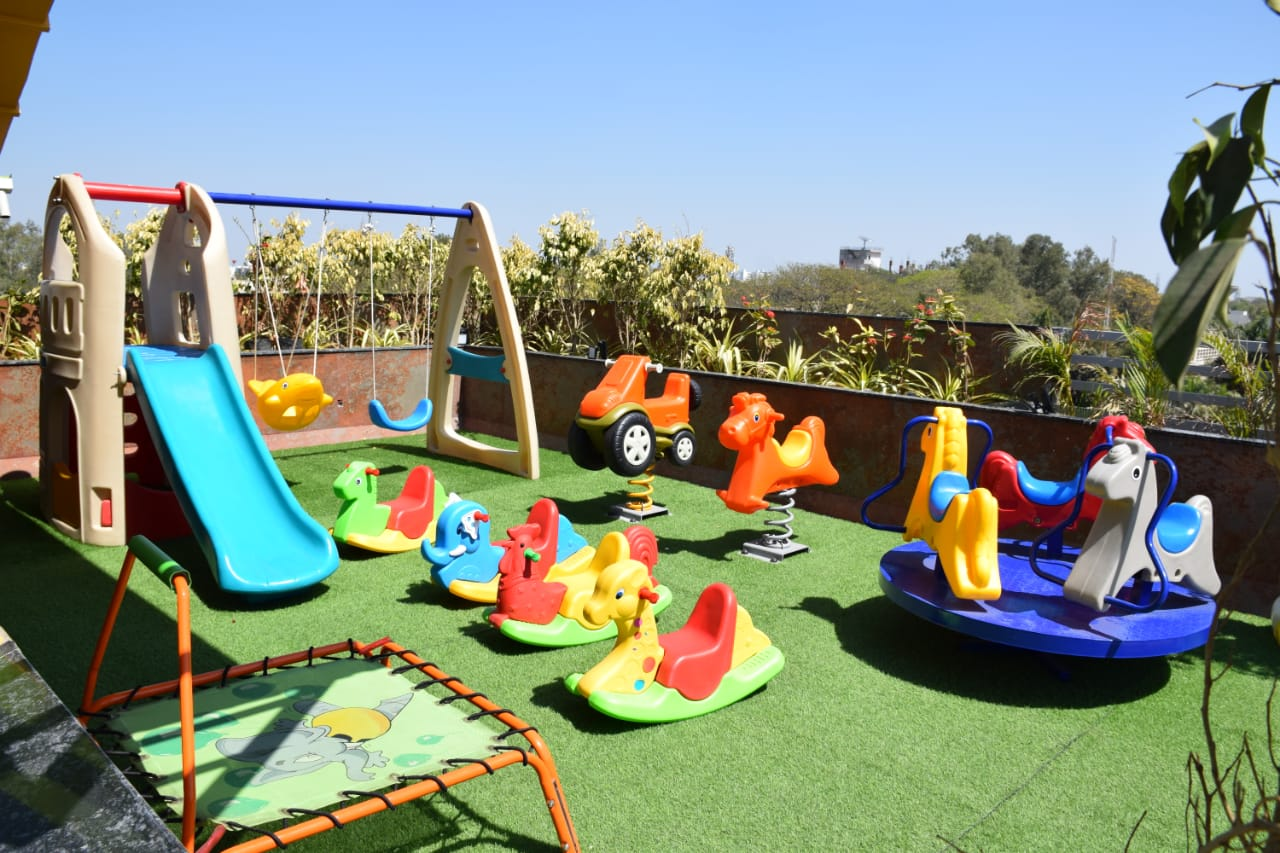 children entertainment activity at terrace of humming bird hotel